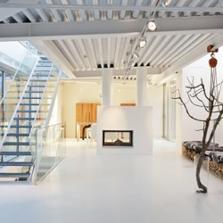 The interior design features distinctive white flooring, walls and ceilings